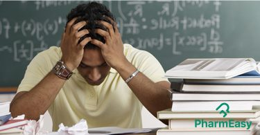 Stressed guy holding his head - How to beat exam stress