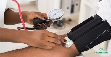 A person measuring blood pressure - What causes high blood pressure