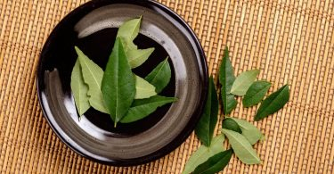 Curry leaves in a bowl