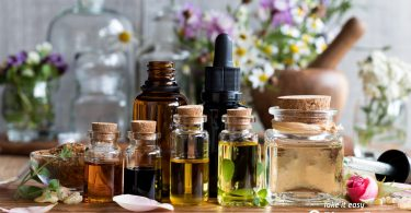 Bottle of Essential Oils on Table