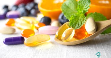 Multivitamin capsules along with foods that are rich source of multivitamins